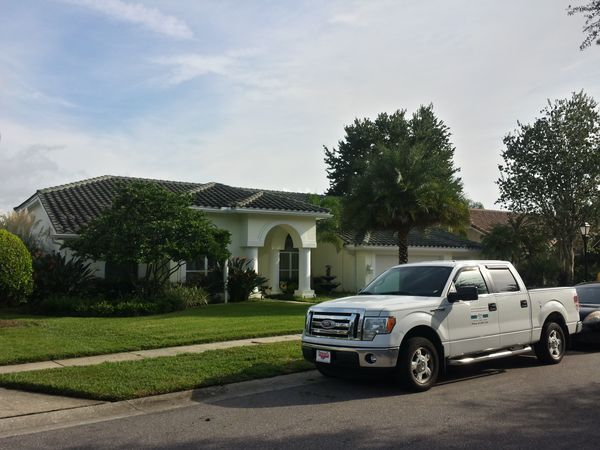 DPI Pressure washing before soft washing roof in Oldsmar