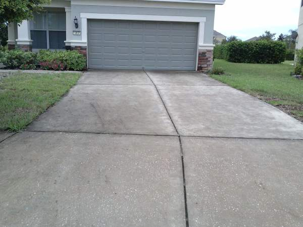 Pressure washing walk and driveways for Pressure wash concrete patio