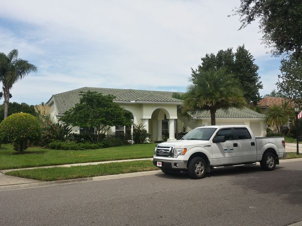 DPI Pressure washing after soft washing roof in Oldsmar