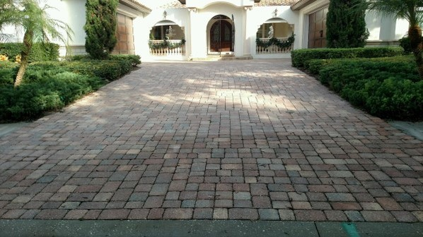 Walk- and Driveway before pressure washing and sealing the pavers