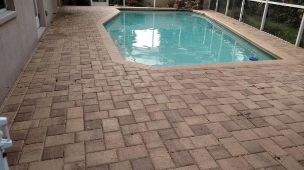 Pool pavers before pressure washing and sealing