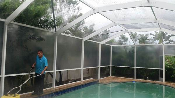 Pool Cage cleaning in progress in Trinity, Fl