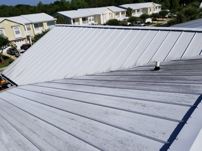 DPI pressure washing a metal roof in Tampa Bay area