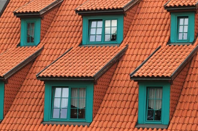 DPI cost of roof cleaning - close up of terracotta roof tiles