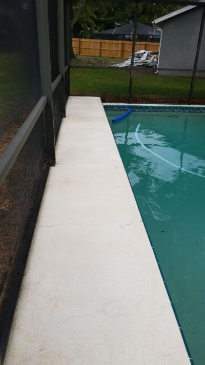 pressure washing port richey pool patio side after