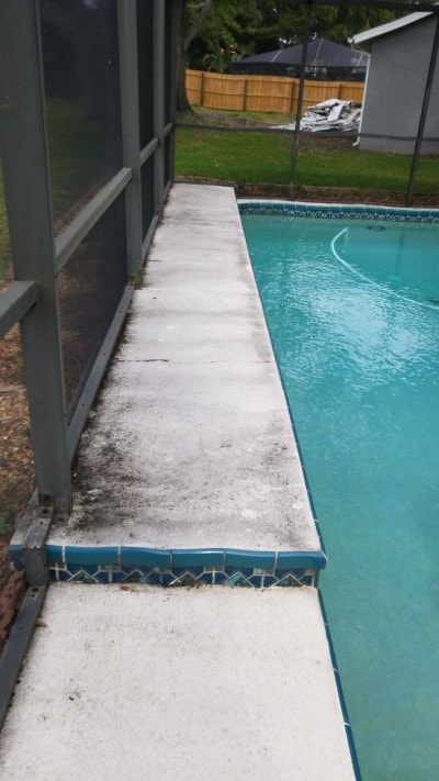 pressure washing port richey pool patio side before